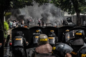 Riot police and protesters in Jakarta, Indonesia