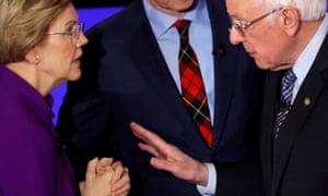 Elizabeth Warren and Bernie Sanders face off at the Democratic debate in Des Moines, Iowa.