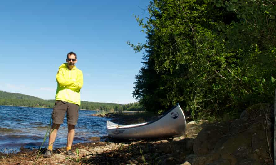 The author Dixe Wills with a Canadian canoe