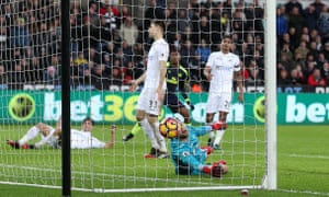 Swansea City's Jack Cork scores own goal goal from a deflected shot by Arsenal's Alex Iwobi for Arsenal's second goal of the game.