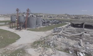 An aerial view shows a damaged cereals silo, close to a residential area in Khan Sheikhun in Idlib, after a suspected chemical attack.