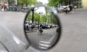 Much of Amsterdam's road and parking space remains allocated to cars.