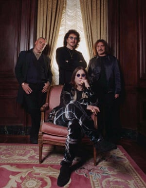 "Heavy metal band Black Sabbath pose in New York in 1998. Seated is Ozzy Osbourne. Standing from left are; Bill Ward, Tony Iommi and Geezer Butler. The band is getting ready for a North American tour to promote a new live record, ""Reunion."""