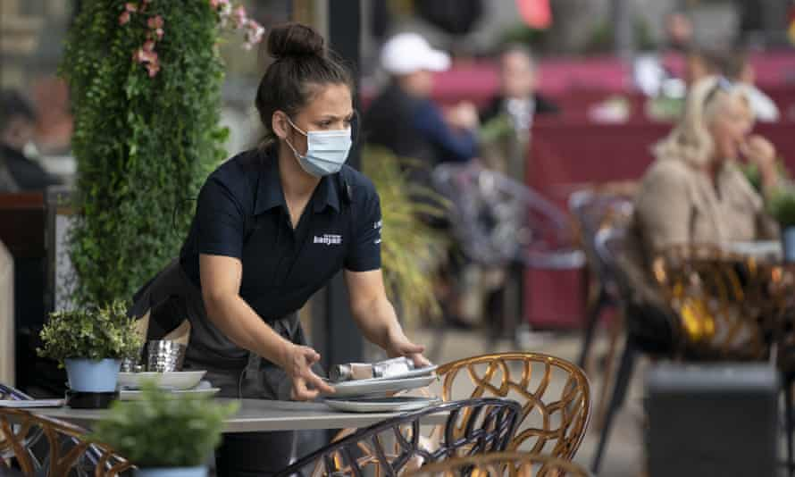 A masked waitress in Manchester, September 2020, before England's lockdown.
