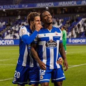 Keko Gontán (left) celebrates with Claudio Beauvue after the forward opened the scoring.
