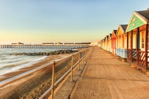 Pathway to the pier Southwold beach huts and its pier as from the beach path way Photograph: Ruth Grindrod/GuardianWitness