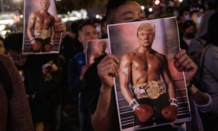 Pro-democracy protesters hold posters of Donald Trump during a Thanksgiving Day rally in Hong Kong in 2019