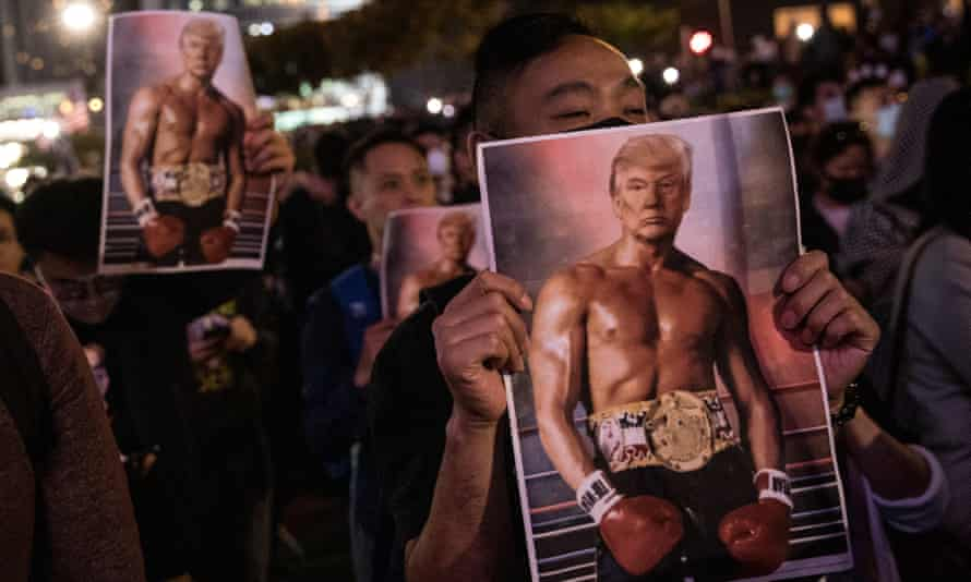 Protesters hold posters of US president Donald Trump during a Thanksgiving Day rally.