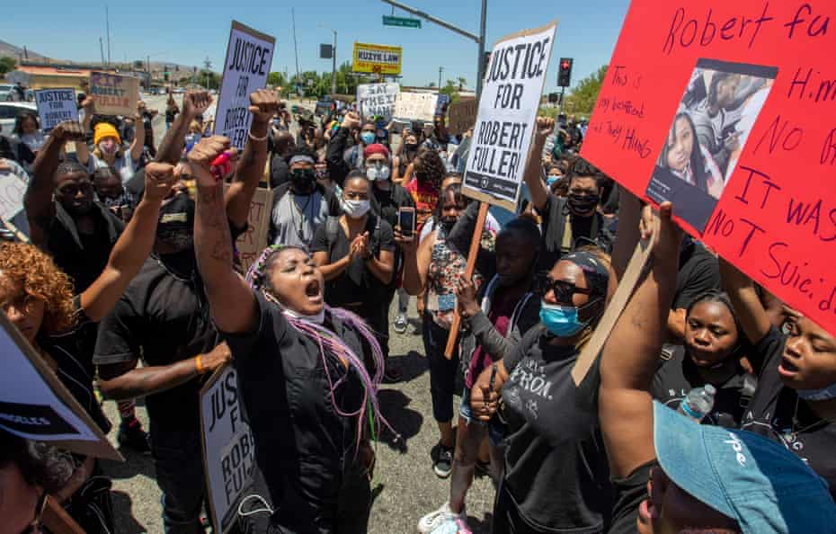 Paris Draper, left, leads hundreds of protesters in chants for justice after Fuller's death.