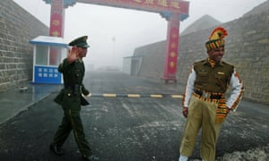 Chinese and Indian soldiers at the Nathu La border crossing between India and China in India's north-eastern Sikkim state.