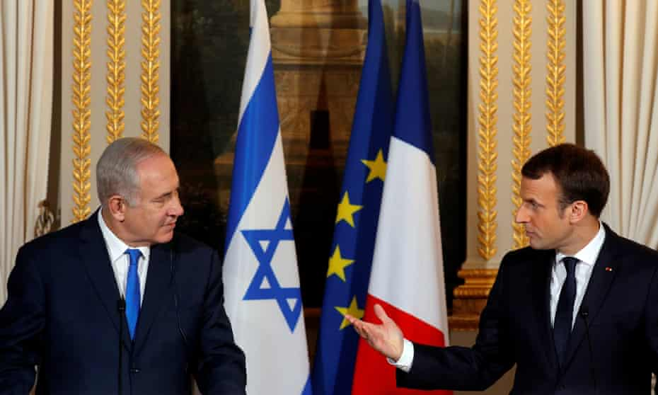 Benjamin Netanyahu and Emmanuel Macron attend a joint news conference at the Elysée Palace in Paris