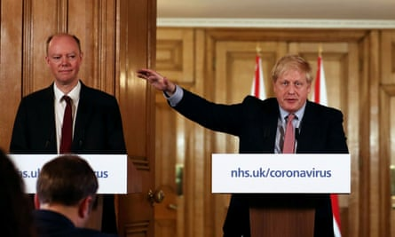 Boris Johnson with England's chief medical officer Chris Whitty, left.