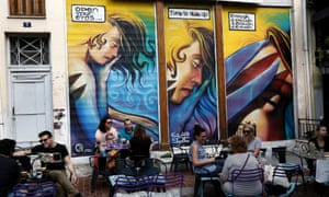 People sit on the tables of a cafe in central Athens yesterday.
