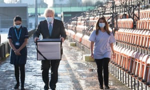 Boris Johnson loading doses of the Oxford/AstraZeneca Covid-19 vaccine for mobile distribution at Barnet FC's ground, The Hive, this morning.