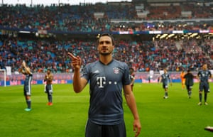 Mats Hummels and the Bayern players go to applaud their fans after the final whistle.