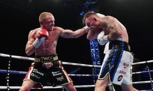 Luke Jackson catches Carl Frampton in their WBO interim featherweight title fight at Windsor Park last year.