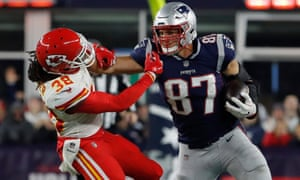 Rob Gronkowski stiff-arms Ron Parker as he makes his mark late in the game