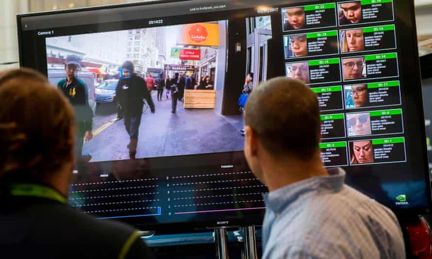 A display shows a facial recognition system for law enforcement during a technology conference.