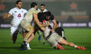 Beka Saghinadze (left) and Beka Gorgadze of Georgia tackle Justin Tipuric of Wales which later results in a yellow card being shown to Beka Saghinadze.