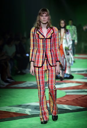 A model in plaid on the Gucci menswear catwalk.