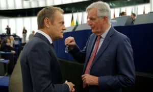 The EU's chief Brexit negotiator, Michel Barnier (right), talks with Donald Tusk, the president of the European council
