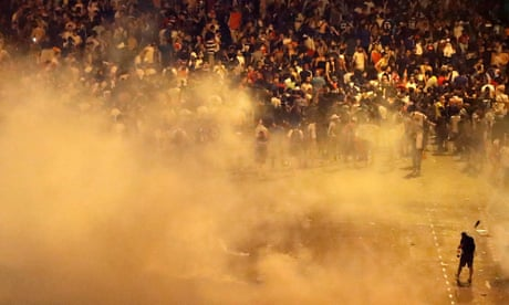 Police and football fans clash in Paris after France's World Cup victory – video