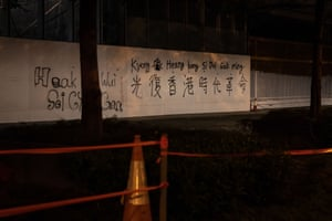 A graffiti of Cantonese Romanisation, 'Liberate Hong Kong, Revolution of Our Times', outside the Legislative Council after pro-democracy protesters marched on 18 August in Hong Kong