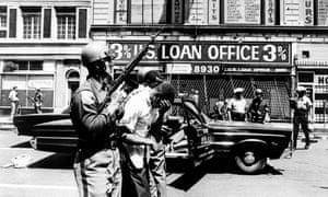 Policemen arrest black suspects on 12th street on 25 July 1967.