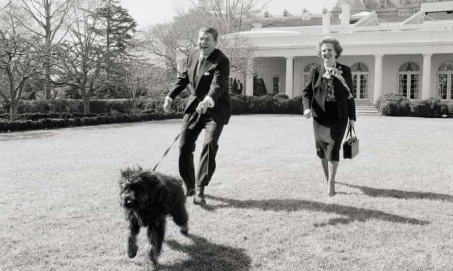 Ronald Reagan and Margaret Thatcher walk Reagan's dog Lucky on the White House lawn.
