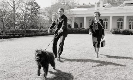Margaret Thatcher and Ronald Reagan walking his dog, Lucky, on the White House lawn