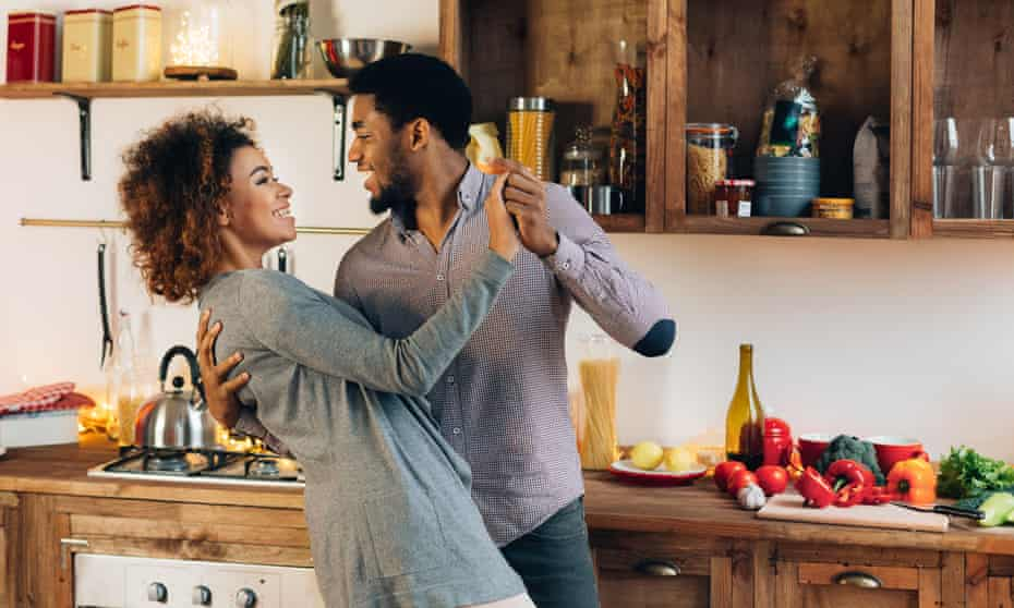 Young couple dancing in a kitchen
