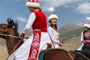 A group of Kyrgyz female stunt riders take time out from the games to ride together and talk