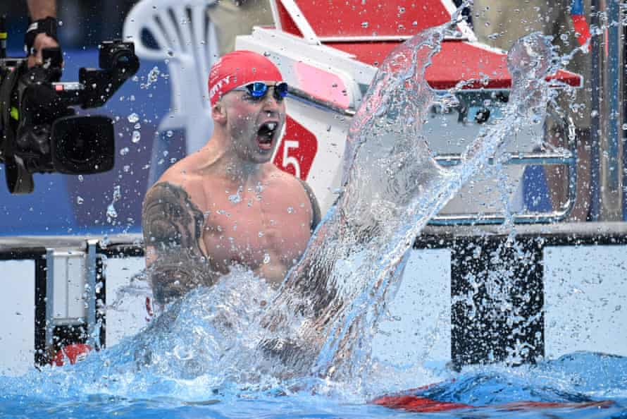 Adam Peaty makes a splash after winning gold in the final of the men's 100m breaststroke
