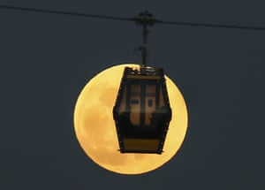 Lit up on high: a cable car crosses in front of the moon in Ankara.