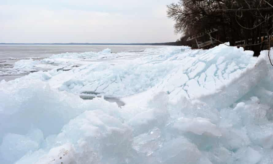 Ice piles up on the shore of a lake in Minnesota.