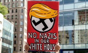 A demonstrator is seen holding a sign at a rally held in New York.