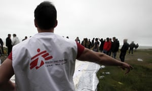 An MSF member at a makeshift camp near Dieppe, northern France.