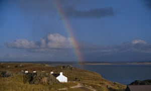 a small cottage in Wale with rainbow