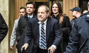 Harvey Weinstein leaves the New York criminal court on Thursday, trailed by his lead lawyer, Donna Rotunno (behind, to the right).