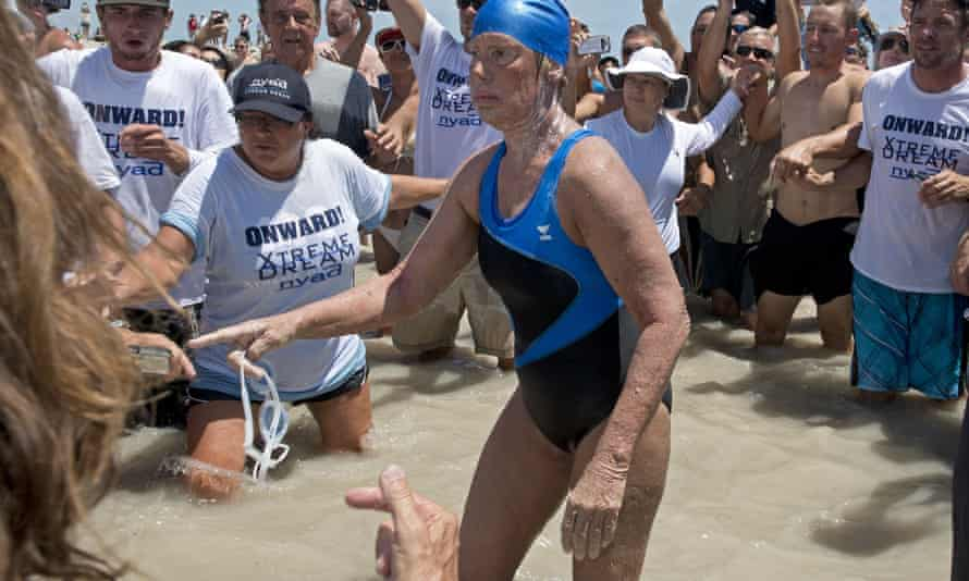 Diana Nyad emerges from the the water after completing the 110-mile swim from Cuba to Key West, Florida, on September 2, 2013.