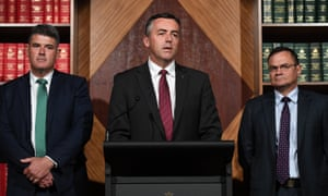 Peter Foley, the project director for the operational search for Malaysia Airlines flight MH370, the Australian transport minister, Darren Chester, and Greg Hood, of the Australian Transport Safety Bureau