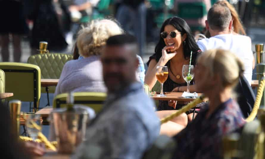People drink in a bar in Covent Garden in London last autumn. On Wednesday Boris Johnson told MPs that pubgoers could be asked to provide proof they have been inoculated.