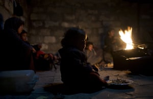 Khan Younis, GazaA Palestinian family warm themselves by a fire during a cold weather spell in a slum on the outskirts of the refugee camp