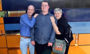 Liam McGarrigle (centre) at the federal court in Melbourne with his parents Michael and Michelle