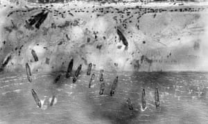 Troops landing on D-day at Sword beach, France taken from a photo reconnaissance Mustang aircraft, 6 June 1944.