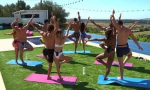Love Island contestants doing couple's yoga