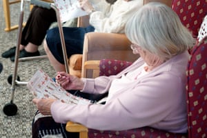 A resident enjoys a game of picture bingo as staff try to ensure normal routines are continued as much as possible during the Coronavirus lockdown.