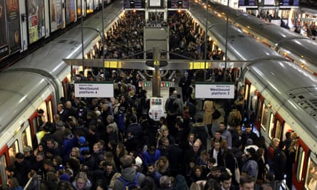 Passengers and trains at Earl's Court station in London