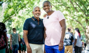 (From left) Kevin Ramos and partner Errol McTear pose for a portrait at the Pure Heat Community Festival at Piedmont Park in Atlanta, Ga. on 2 Sept. 2018. The festival is the largest event of Atlanta Black Pride weekend. Photograph: Bita Honarvar © 2018 Bita Honarvar
