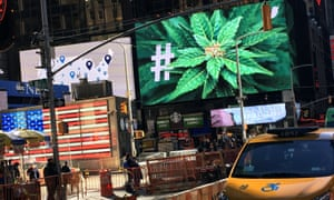 An electronic billboard displays a marijuana hashtag at Times Square in New York.
